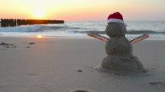 Hot Christmas Vacation sandy snowman with santa hat - stock footage
