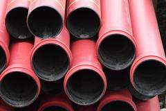 Sewerage construction material: stack of plastic pipes - stock photo