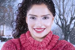 Stock Photo of Indian woman smiling lovely in wintertime