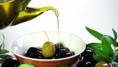 On olives in a bowl pouring olive oil Stock Footage