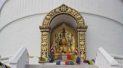 Buddha statue in the stupa (World Peace Pagoda) Stock Footage