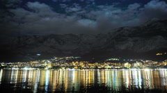 Makarska at night, the reflection of lights along the beach. Stock Footage