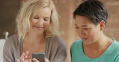 Friends at home having fun laughing using smart phone Stock Footage