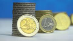 Euro coins on the edge and stacks (euro & cents) - panoramic and focus change Stock Footage