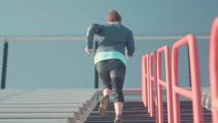 Female Athlete Running Up Bleachers Slow Motion Stock Footage