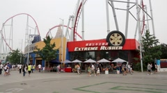 Roller coaster restaurant KFC in the amusement park Happy Valley Beijing Stock Footage