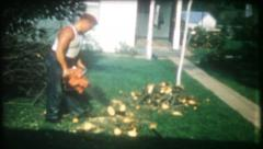 2848 - man uses chain saw to cut firewood - vintage film home movie - stock footage