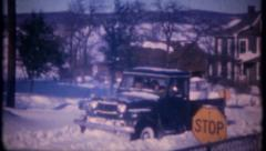 2854 - classic 4 wheel jeep drives through snow - vintage film home movie Stock Footage