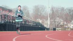 Stock Video Footage of Female Athlete Running on Track