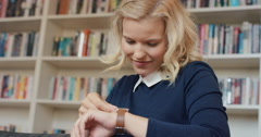 Beautiful woman using smart watch checking messages at home Stock Footage