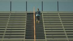 Female Athlete Running Up and Down Bleachers Stock Footage