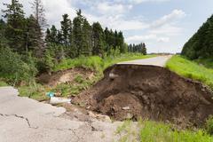 Flood damaged washed out road - stock photo