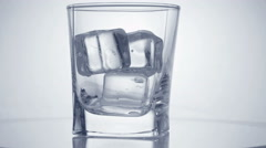 Glass with ice cubes. Stock Footage