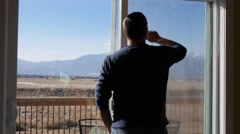 A man cleans house windows during the day Stock Footage