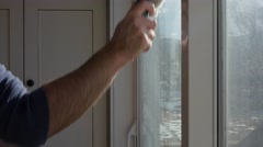 A man cleans house windows Stock Footage