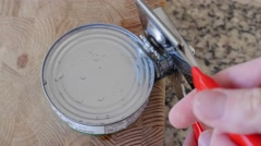 A man opens a can of tuna fish Stock Footage