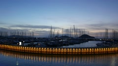 Yacht marina by night with moored sailing boats  in Mediterranean Sea. 4k Stock Footage