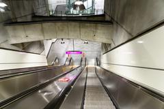 People Traveling On Escalator To Train Subway Station In Downtown Vienna Stock Photos