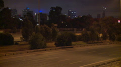 Freeway with city Skyline at 2.5 miles 4 Km's Stock Footage