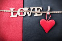 hearts made of felt and the word love - stock photo