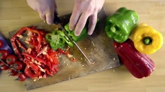 Cutting peppers view from above Stock Footage