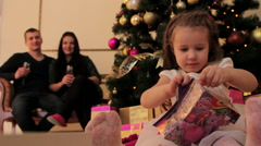 Little Girl Unpacking the Toy Presented by Her Parents Stock Footage