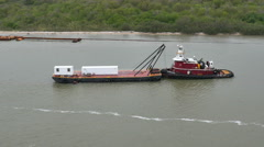 POV-Passing tug boat and barge in the channel at Galveston Harbor Stock Footage