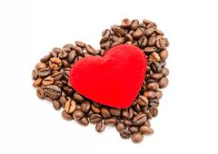 Stock Photo of Coffee and velvet heart on white background