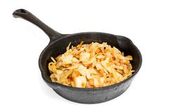 Fried cabbage in a skillet on a white background Stock Photos