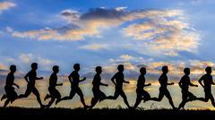 series of a jogger in sundowm - stock photo