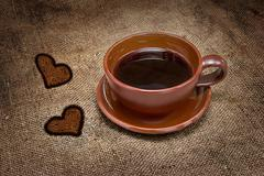 Black coffee in a cup on a brown background burlap Stock Photos