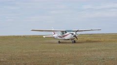 Stock Video Footage of Cessna 182L Skylane Aircraft taxiing on the airfield