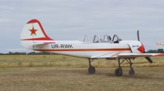 Two Yakovlev Yak-52 aircraft taxiing to the runway Stock Footage