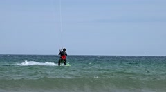Kite surfer performs at the beach Stock Footage