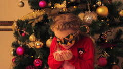 Little Girl in Mask Blowing Artificial Snow Stock Footage