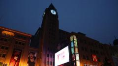 Clock tower on the shopping Wangfujing street in center of Beijing Stock Footage