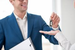 Cheerful male realtor is making a deal - stock photo