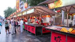 Buyers and sellers in the new street snacks at the Wangfujing street Stock Footage