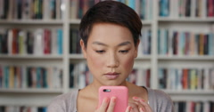 Happy Beautiful woman using smart phone at home - stock footage
