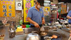 Cook quickly roast mixed meal on flat grill, right in front of customers Stock Footage