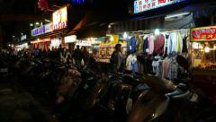 Dark outside, night marked side street, garments stalls - stock footage