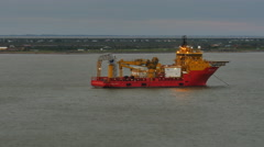 POV-Passing moored brightly colored ship with lights at dusk at Galveston Harbor Stock Footage