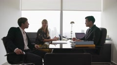 Young Couple Talking With Financial Advisor In Modern Office Stock Footage