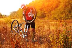 Bike repair. Young man repairing mountain bike Stock Photos