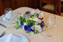 Beautiful wedding boquet lying on table in restaurant Stock Photos