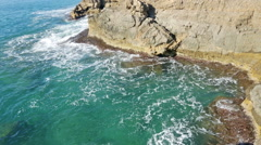 Cliffs at ocean  coast  in tranquil  day Stock Footage
