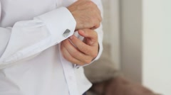the groom wears cufflinks - stock footage
