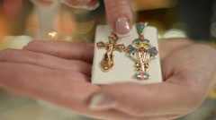 Jewels Market - the seller shows gold jewelry cross - stock footage