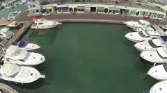 Yachts moored in the touristic port of Lavagna during the pool party Stock Footage