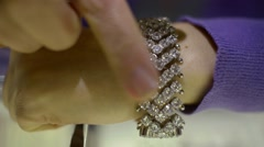 Market jewels - the seller shows silver jewelry bracelet with brilliants Stock Footage